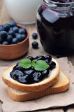 Bread with blueberry jam Royalty Free Stock Photos