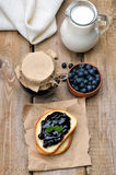 Bread with blueberry jam on wooden table Royalty Free Stock Photo