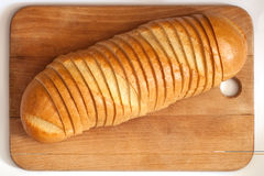 Bread on a board. Cutting bread on a board Royalty Free Stock Photography