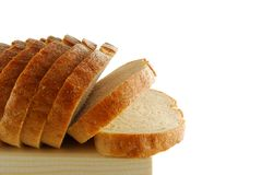 Bread on the board. Slices of bread on the board on the white background stock photo