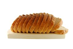 Bread on the board. Slices of bread on the board on the white background stock photos