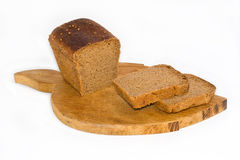 Bread on a board for cutting. Bread on board for cutting on a white background Royalty Free Stock Image