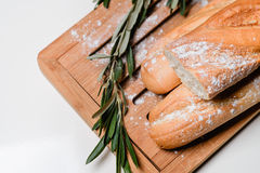 Bread on a board. Sliced baguettes on the board Stock Images