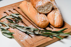 Bread on a board. Sliced baguettes on the board Stock Photography