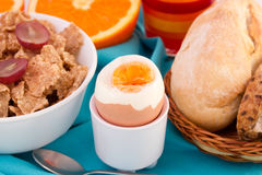Bread with boiled egg, cereals. And juice Royalty Free Stock Photos