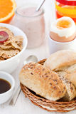Bread with boiled egg, cereals, yogurt Royalty Free Stock Photo