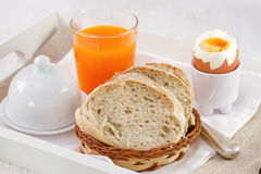 Bread with boiled egg and orange juice Royalty Free Stock Image