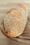 Bread on breadboard. Fresh crusty bread on wood background Royalty Free Stock Photos