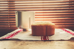 Bread and breadmaker tine by the window Stock Photos
