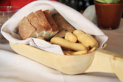 Bread and breadsticks in a wooden tray Stock Photo