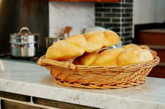 Bread for breakfast. A large bamboo basket of bread for breakfast royalty free stock image
