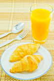 Bread of breakfast on white background. Bread of breakfast with orange juice glass Stock Images
