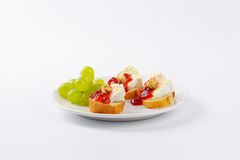 Bread with brie cheese, walnuts, jam and grapes Royalty Free Stock Images