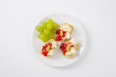 Bread with brie cheese, walnuts, jam and grapes Royalty Free Stock Photos