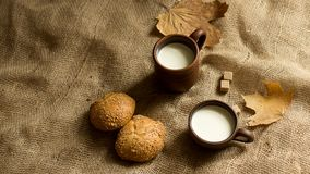 Bread, brown sugar, maple leaf and two cups of milk royalty free stock photos