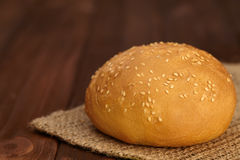 Bread bun for burger in sesame on wooden board Stock Photos