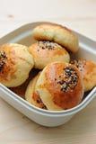 Bread bun in container Stock Photos
