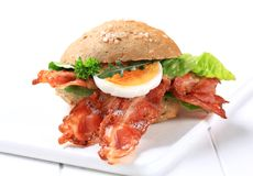 Bread bun with crispy bacon Royalty Free Stock Image