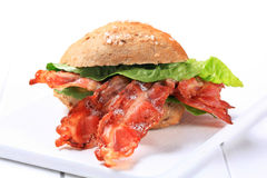 Bread bun with crispy bacon Stock Image