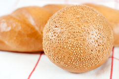 Bread and bun with sesame seeds Royalty Free Stock Photos