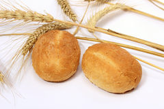Bread  bun and stalks of wheat Royalty Free Stock Image