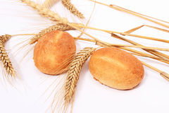 Bread  bun and stalks of wheat Royalty Free Stock Images