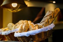 Bread and buns inside wicker basket. On display in a bakery shop Royalty Free Stock Image