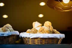 Bread and buns inside wicker basket. On display in a bakery shop Royalty Free Stock Photos
