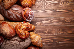 Bread and buns over wooden background Stock Photos