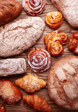 Bread and buns over wooden background Royalty Free Stock Images