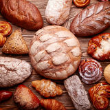 Bread and buns over wooden background Royalty Free Stock Photography