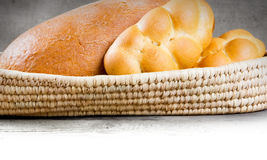 Bread and buns. Bread with buns in a scuttle on wooden background with white space for text Royalty Free Stock Images