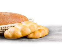 Bread and buns. Bread with buns in a scuttle on wooden background with white space for text Royalty Free Stock Photos