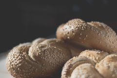 Bread buns with sesame seeds close up. Three bread buns with sesame seeds close up, dark background Royalty Free Stock Photos