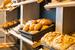 Bread and buns on shelf in bakery or baker's shop Royalty Free Stock Photos