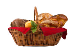 Bread and buns in wicker basket isolated on white.  Stock Photo