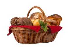 Bread and buns in wicker basket isolated on white Stock Photo