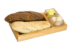 Bread and buns on wooden plate Royalty Free Stock Image