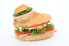 Bread burger bun sandwich. Brown whole grain food isolated on white, macro with copy space, lettuce, tomato and ham Royalty Free Stock Photos