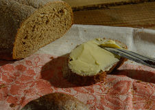 Bread and buter on the wooden table Stock Photography
