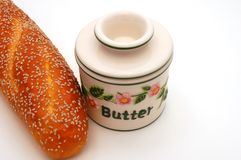Bread and Butter. Bread with sesame seeds and butter dish Royalty Free Stock Photos
