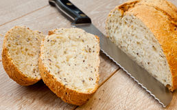 Bread and Butter. Brown bread and butter on a wooden table Stock Images