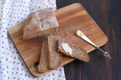Bread and butter. On a wooden board Stock Photo