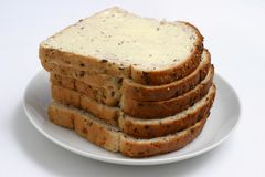 Bread and butter. Slices of buttered bread Royalty Free Stock Image