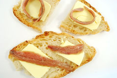 Bread, butter and anchovies Stock Photos