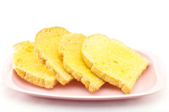 Bread and butter. Bread baked with butter and sugar placed in a pink tray on white background Stock Photography