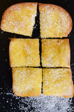 Bread with butter on black background Stock Photos