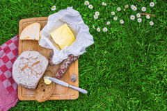 Bread,butter and cheese. Picnic board of bread, butter, cheese and sausage Stock Images