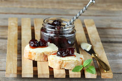 Bread with butter and cherry jam Stock Images