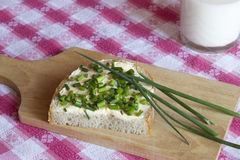 Bread with butter and chives Royalty Free Stock Images